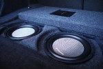 two woofers in a custom enclosure under the floor.